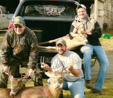 Group of hunters with big bucks